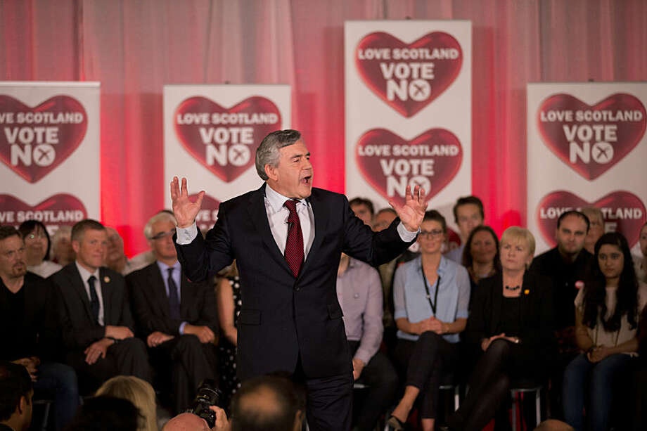 Former British Prime Minister and No campaigner for the Scottish independence referendum Gordon Brown gestures during his speech in at a No campaign event in Glasgow, Scotland, Wednesday, Sept. 17, 2014. Will the ayes have it, or will Scotland say naw thanks? No one is certain. Excitement and anxiety mounted across the country Wednesday, the final day of campaigning before Thursday's referendum on independence. With opinion polls suggesting the result is too close to call and turnout expected to reach record levels, supporters of separation feel they are within touching distance of victory — but wonder whether their surge in the polls will be enough. (AP Photo/Matt Dunham)