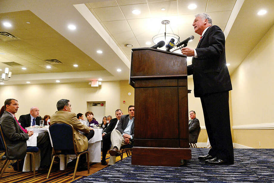 Hour photo / Erik Trautmann Norwalk mayor Harry Rilling gives his first State of the City address at the Doubletree Hotel Thursday afternoon.
