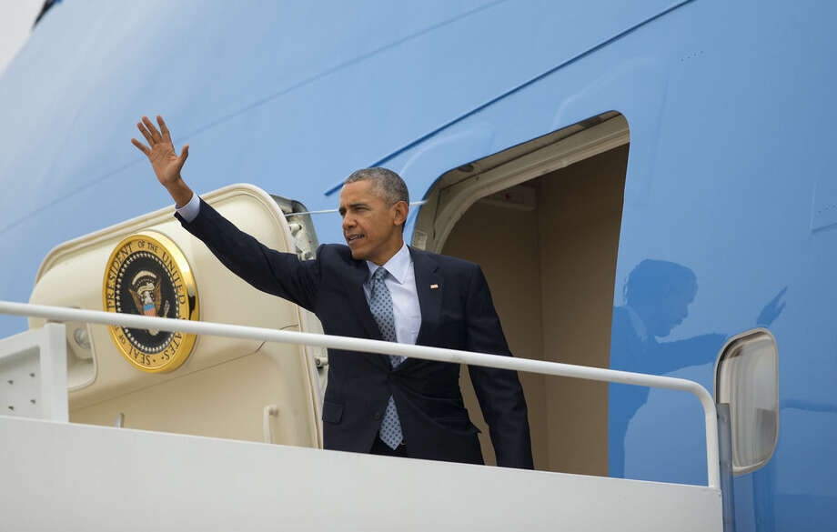 President Barack Obama waves as he boards Air Force One, Tuesday, Oct. 27, 2015 at Andrews Air Force Base. Obama is traveling to Chicago to speak at the International Association of Chief of Police conference and attend democratic fundraisers. (AP Photo/Pablo Martinez Monsivais)