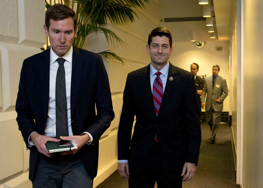 Rep. Paul Ryan, R-Wis., right, walks from a meeting on Capitol Hill in Washington, Monday, Oct. 26, 2015. Speaker John Boehner is pressing ahead with one last deal as he heads for the exits, pushing to finalize a far-reaching, two-year budget agreement with President Barack Obama before handing Congress' top job over to Ryan this week, congressional officials said Monday.(AP Photo/Carolyn Kaster)