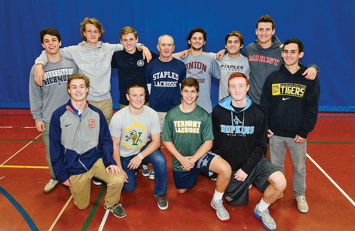 Hour photo / Erik Trautmann Staples High School Lacrosse players; Front row, Tanner Wood, Ethan Burger, Dobson Cooper, Evan Zinn and Ben Scwaeber. Second row, Michael Reale, Connor Chamberlain, Matt Johnson, also coach Paul McNulty, Josh Willis, Ross Goldberg and Sam Ahlgrim, will all play in college. The most ever for Staples.