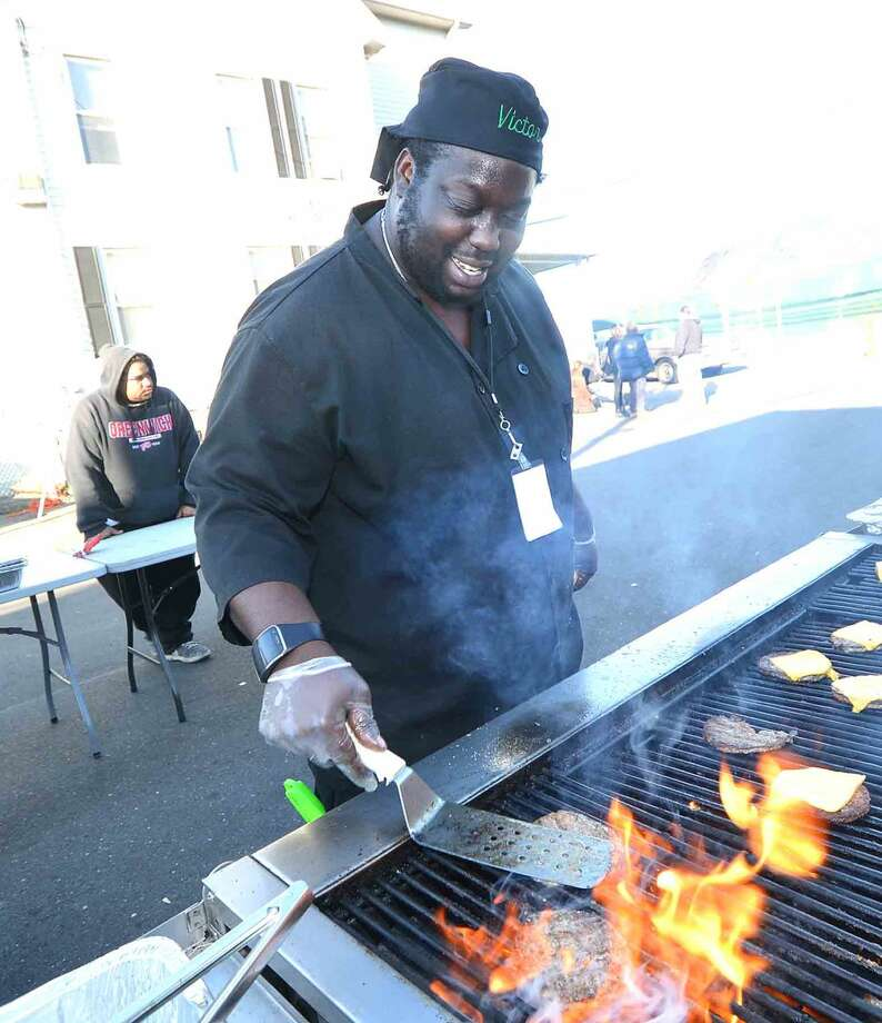 Hour Photo/Alex von Kleydorff Victor Sqire cooks cheeseburgers for a block party at The Open Door Shelter, he will be on the TV reality show Chopped that airs early November