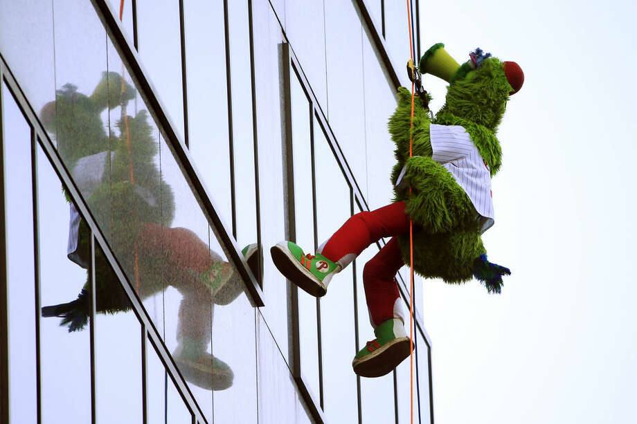 The Philadelphia Phillies' mascot, the Phillie Phanatic, rappels down a skyscraper as part of a annual fundraiser Friday, Oct. 23, 2015, in Philadelphia. The event was a fundraiser for the Outward Bound School, which offers outdoor programs aimed at building character and leadership skills. (AP Photo/Matt Rourke)