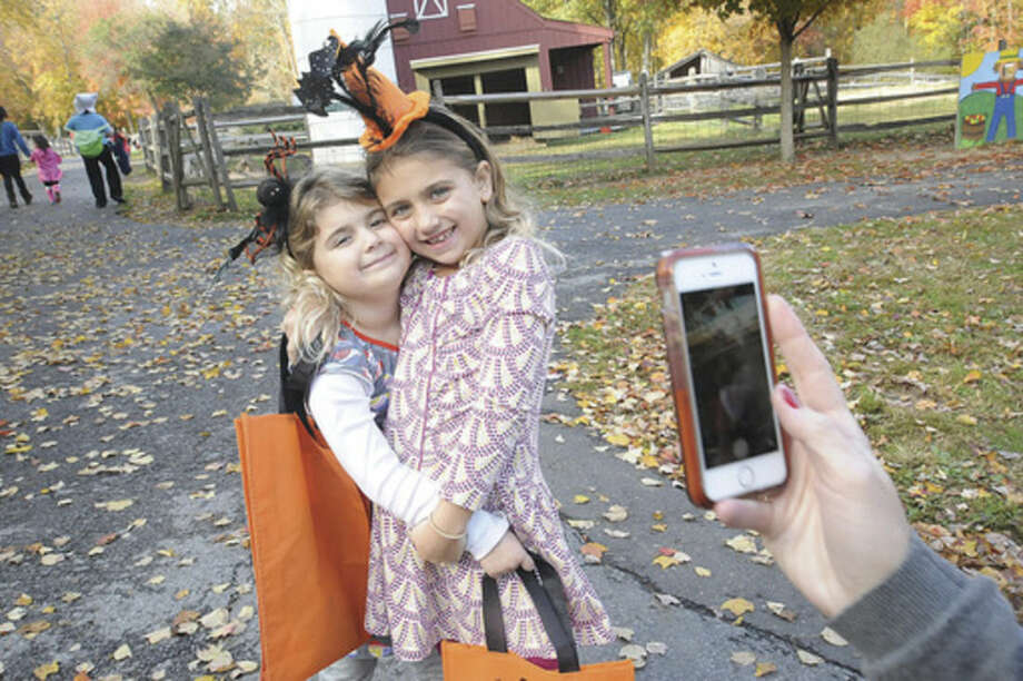 "Hour photo Matthew VinciSarah Buttacavo, 5, and her sister Alayna, 7, pose for a cellphone photo at the ""Ick Fest"" held at the Stamford Museum and Nature Center on Sunday."