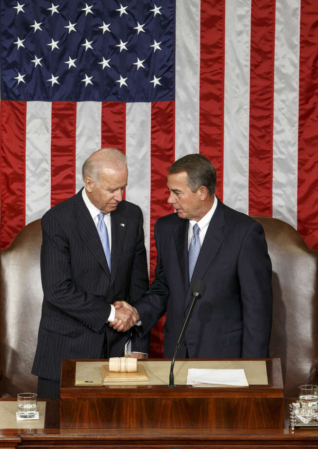 Vice President Joe Biden, left, acting as the president of the Senate, shakes hands with Speaker of the House John Boehner, R-Ohio, right, at the close of a joint meeting of Congress, at the Capitol in Washington, Thursday, Sept. 18, 2014, following a speech by Ukranian President Petro Poroshenko. The House and Senate are wrapping up business and heading to their home states for the weeks leading up to the midterm elections. (AP Photo/J. Scott Applewhite)