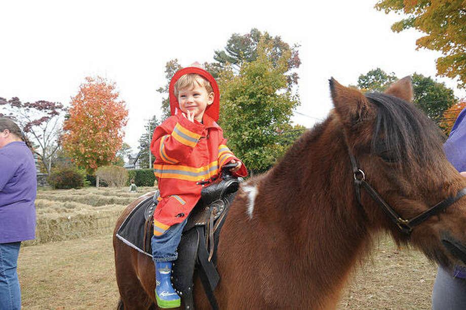 2 year old Monte Boyce rides a pony at the Rowayton Community Center's Halloween Celebration on Sunday. Hour photo/Matthew Vinci