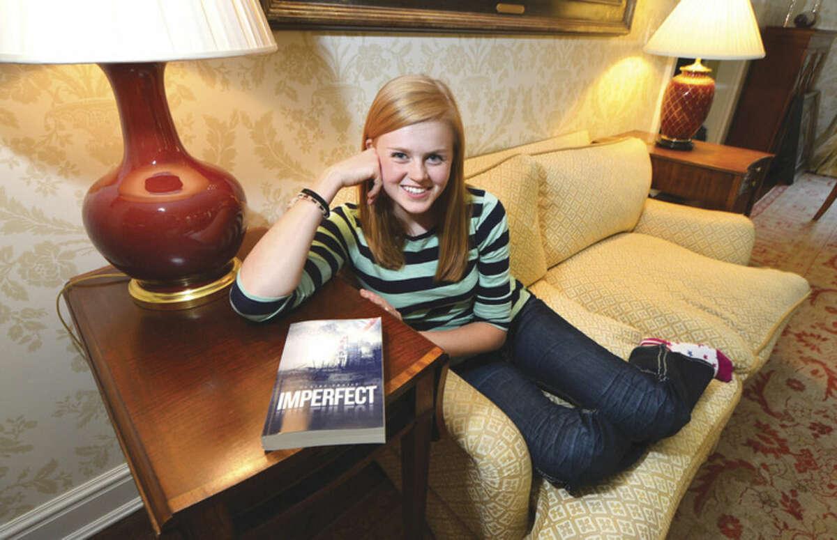 "Hour photo/Alex von Kleydorff 16-year-old Wilton author Claire Fraise with her debut novel, ""Imperfect."""