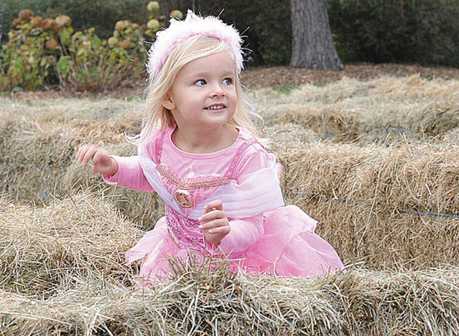 3 year old Eleane Freeman makes her way through a hay maze at the Rowayton Community Center's Halloween Celebration on Sunday. Hour photo/Matthew Vinci