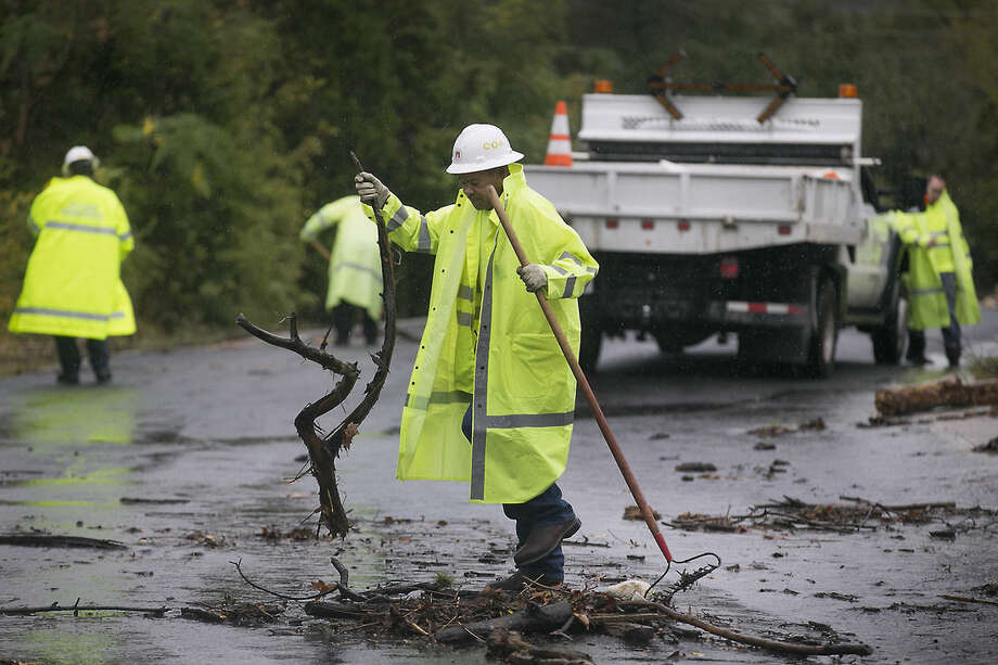 Floyd Taylor, with the City of Austin Watershed Protection department, cleans debris Saturday, Oct. 24, 2015, in Austin, Texas. A powerful storm system moved through Texas on Saturday, flooding roads and causing a freight train to derail as parts of the state braced for the remnants of Hurricane Patricia to arrive. (Ralph Barrera/Austin American-Statesman via AP) AUSTIN CHRONICLE OUT, COMMUNITY IMPACT OUT, INTERNET AND TV MUST CREDIT PHOTOGRAPHER AND STATESMAN.COM, MAGS OUT; MANDATORY CREDIT