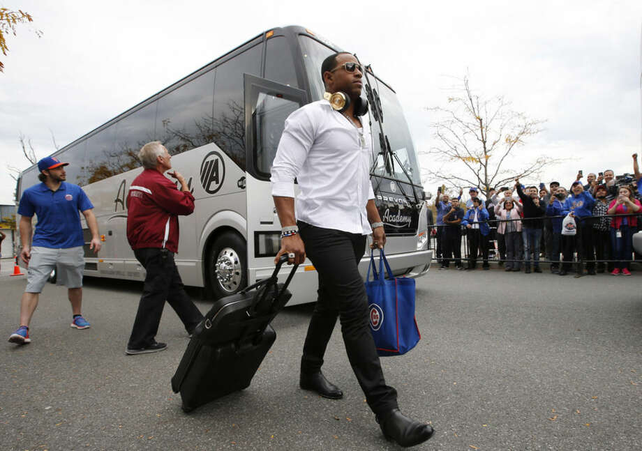 New York Mets' Orlando Cespedes walks with his luggage Thursday, Oct. 22, 2015, in New York. The Mets swept the Chicago Cubs to win the National League Championship. (AP Photo/Kathy Willens)