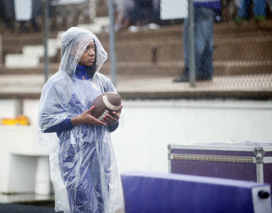 Texas College cheerleader sophomore Shan Moore wears a poncho on the sideline an NCAA college football game between Arizona Christian and Texas College, Saturday Oct. 24, 2015, in Tyler, Texas. Southeast Texas was bracing for heavy rain late Saturday and into Sunday as the remnants of Hurricane Patricia combined with a powerful storm system moves across Texas. (Sarah A. Miller/Tyler Morning Telegraph via AP) MANDATORY CREDIT