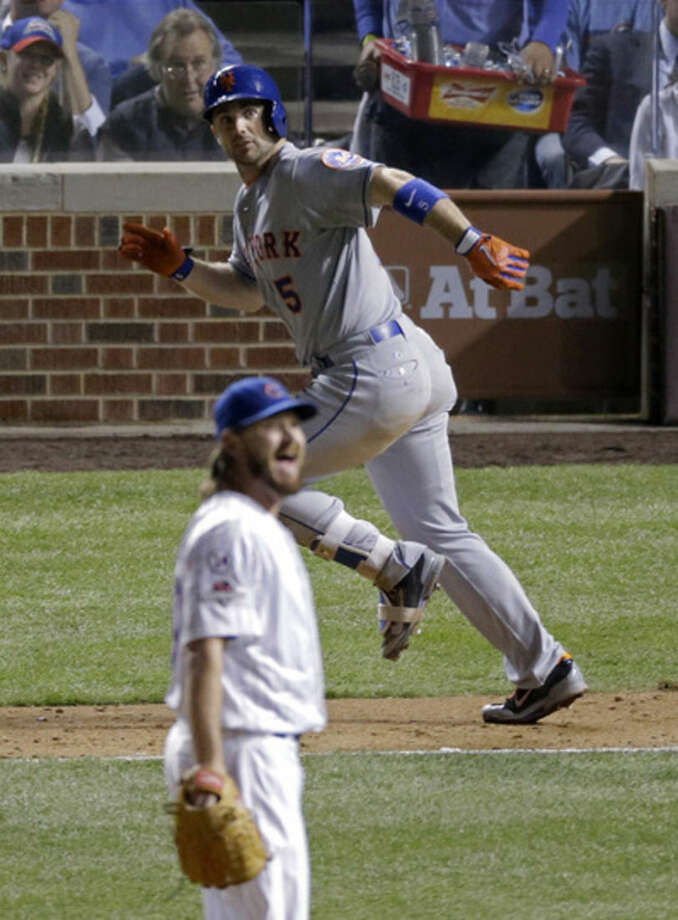 Chicago Cubs pitcher Travis Wood reacts to a double by New York Mets' David Wright during the seventh inning of Game 3 of the National League baseball championship series Tuesday, Oct. 20, 2015, in Chicago. (AP Photo/David Goldman)
