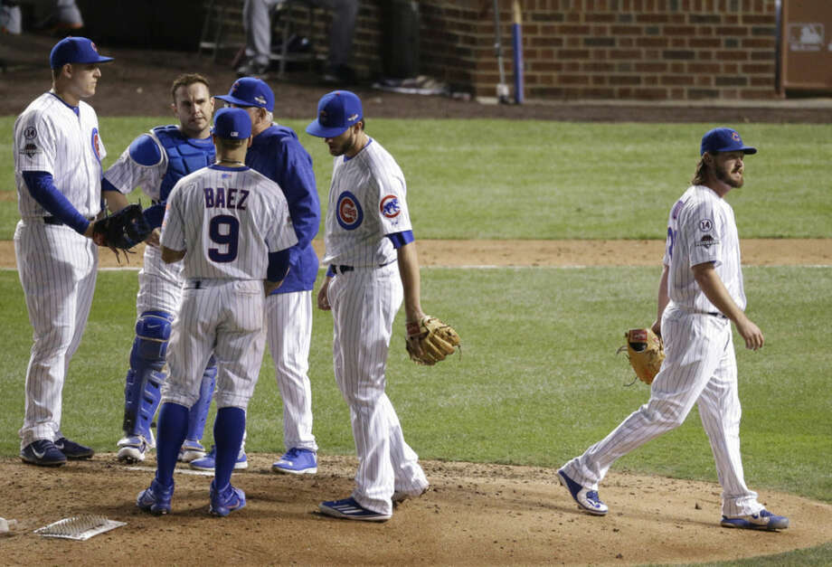 Chicago Cubs' Travis Wood is relieved during the seventh inning of Game 3 of the National League baseball championship series against the New York Mets Tuesday, Oct. 20, 2015, in Chicago. (AP Photo/David Goldman)