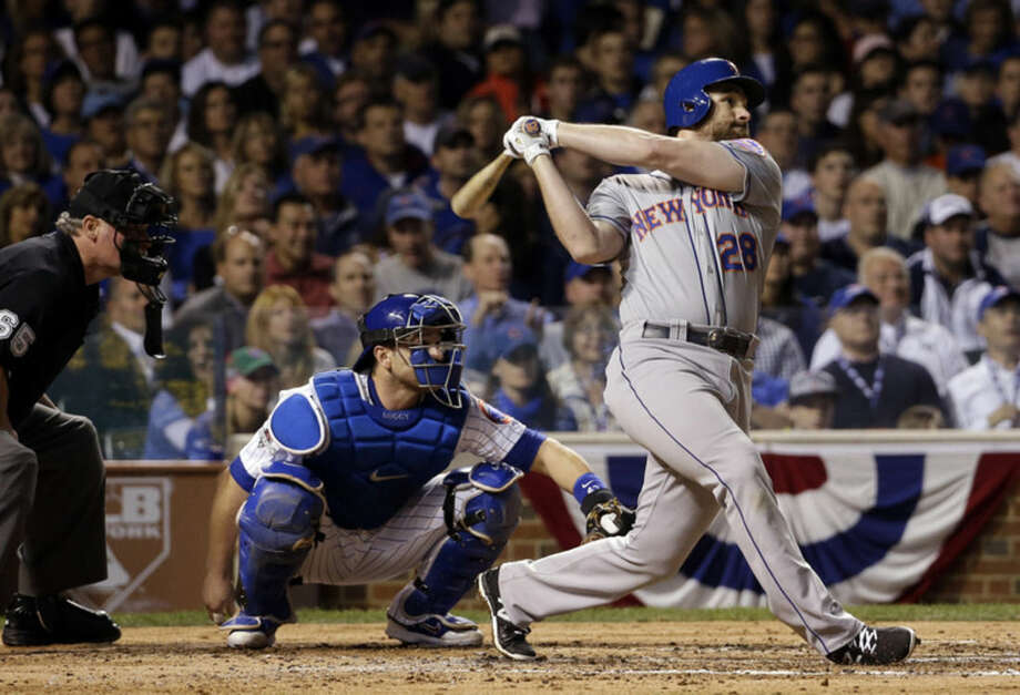 New York Mets' Daniel Murphy hits a home run during the third inning of Game 3 of the National League baseball championship series against the Chicago Cubs Tuesday, Oct. 20, 2015, in Chicago. (AP Photo/David J. Phillip)