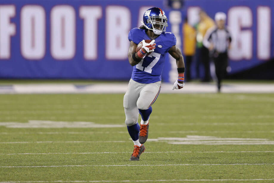 New York Giants wide receiver Dwayne Harris (17) returns a kick for a touchdown during the second half of an NFL football game Sunday, Oct. 25, 2015, in East Rutherford, N.J. (AP Photo/Seth Wenig)