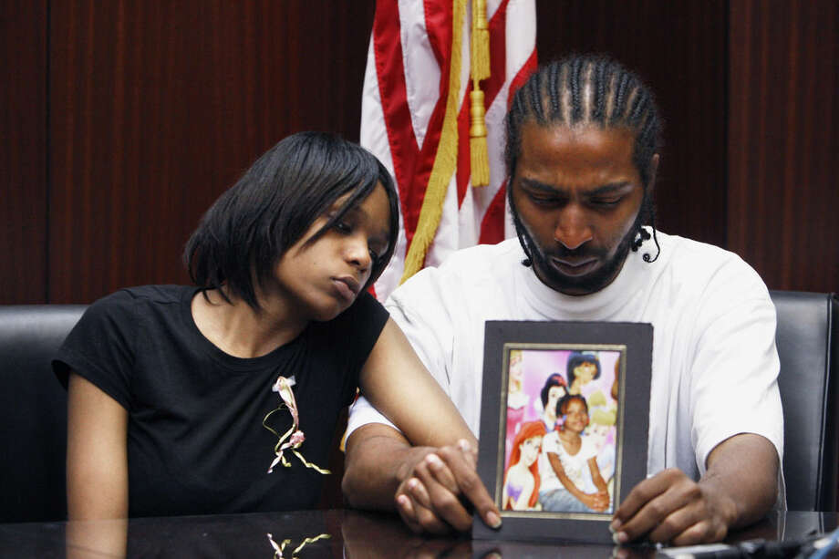 "FILE -- In this May 18, 2010 file photo, Dominika Stanley, left, the mother of 7-year-old Aiyana Jones sits next to Aiyana's father Charles Jones in attorney Geoffrey Fieger's office in Southfield, Mich. A judge won't delay the trial of a Detroit police officer who accidentally killed 7-year-old Aiyana Jones during a raid, despite his attorney's concerns that a ""media frenzy"" following a police shooting in Missouri could harm his client's right to an impartial jury. Detroit Officer Joseph Weekley is charged with involuntary manslaughter. Wayne County Judge Cynthia Hathaway said Weekley's trial will start Monday, Sept. 15, 2014 as planned. This is Weekley's second trial. The first ended without a verdict in June 2013. (AP Photo/Carlos Osorio, File)"