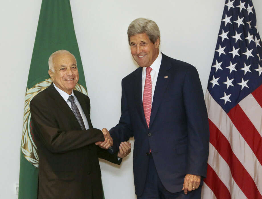 U.S. Secretary of State John Kerry, right, shakes hands with Secretary-General of the Arab League Nabil Elaraby before their meeting in Cairo, Egypt, Saturday, Sept. 13, 2014. Kerry arrived in Cairo for a short visit of less than a day to discuss how Egypt can help in the fight against the Islamic State group. He has been on a regional trip to garner support for President Barack Obama's initiative to go assemble a coalition of nations willing to go after the militant group. Kerry heads to Paris next for a meeting on how to support Iraq in its fight against the Islamic State group, which holds large parts of Iraq and Syria. (AP Photo/Amr Nabil)