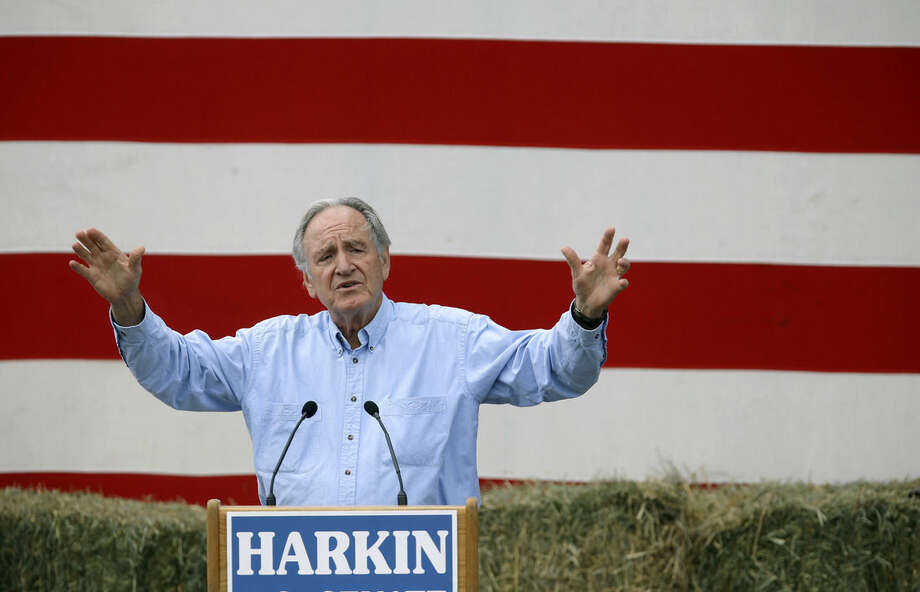 "FILE - In this Sept. 15, 2013, file photo, Iowa Sen. Tom Harkin speaks during his annual fundraising steak fry dinner Indianola, Iowa. If Democrat Bruce Braley is to replace retiring senator Harkin, he'll need some of Harkin's ""prairie populism"" and Clinton star power to pump energy into a so-far pedestrian campaign. Harkin's annual steak fry this weekend will feature feel-good tributes to the five-term senator, all in the glow of former President Bill Clinton and Hillary Rodham Clinton. (AP Photo/Charlie Neibergall, File)"
