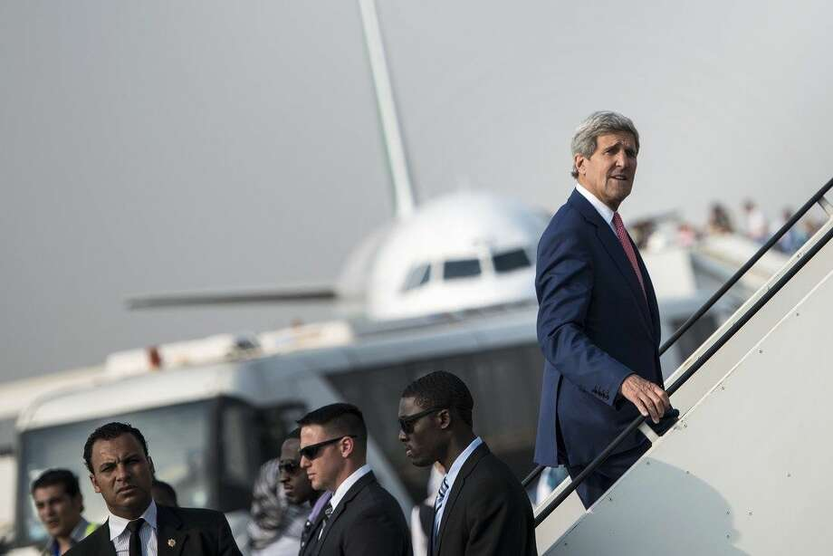 "U.S. Secretary of State John Kerry boards his plane at Cairo International Airport on September 13, 2014 as he leaves the Egyptian capital. Kerry described Egypt as an ""important partner"" during a short stop in Cairo to build support against the Islamic State group in Iraq and Syria. (AP Photo/Brendan Smialowski)"