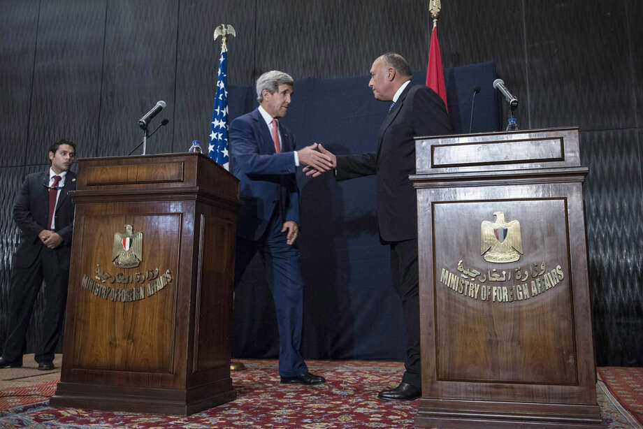 "U.S. Secretary of State John Kerry, left, shakes hands with Egyptian Foreign Minister Sameh Shukri at the end of a joint press conference in Cairo, Egypt, on Saturday, Sept. 13, 2014. Kerry described Egypt as an ""important partner"" during a short stop in Cairo to shore up support for President Barack Obama's initiative to assemble a coalition of nations to go after the Islamic State group, which holds large parts of Iraq and Syria. (AP Photo/Brendan Smialowski, Pool)"