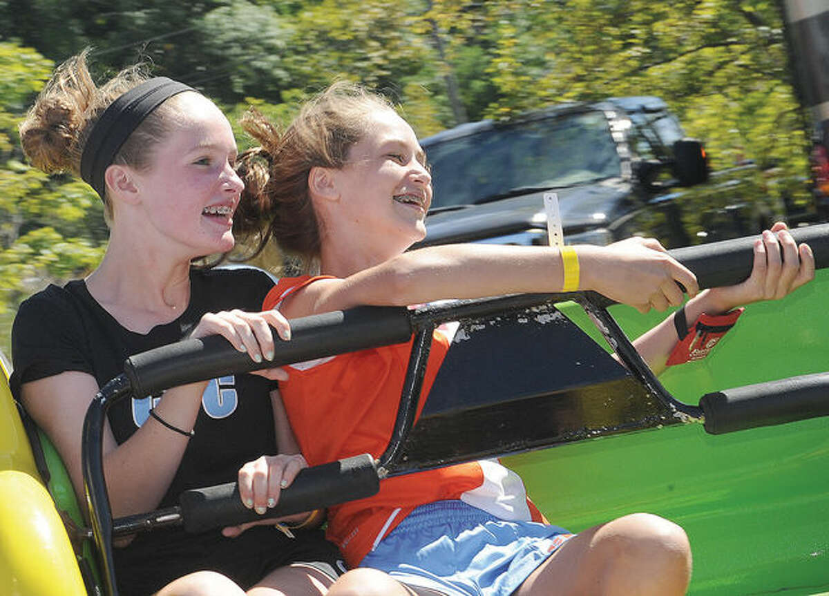 Abbey Brown 12 and Veronica Smith 13 on the Sizzler ride Sunday at the Wilton Rotary Carnival. Photo/Matthew Vinci