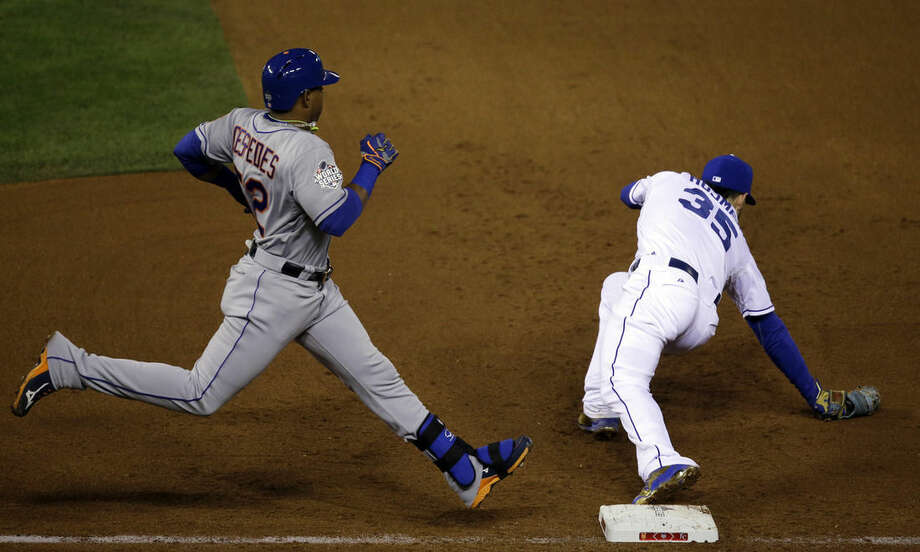 New York Mets' Yoenis Cespedes is safe at first as Kansas City Royals' Eric Hosmer (35) is off the bag during the fourth inning of Game 2 of the Major League Baseball World Series Wednesday, Oct. 28, 2015, in Kansas City, Mo. (AP Photo/David Goldman)