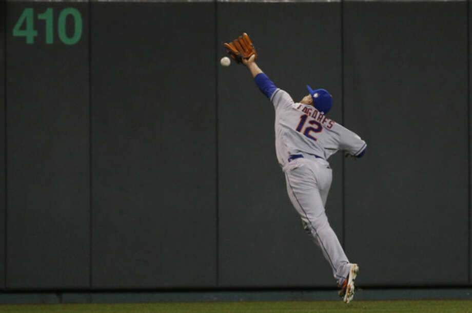 New York Mets center fielder Juan Lagares can't catch an RBI double by Kansas City Royals' Alex Gordon during the eighth inning of Game 2 of the Major League Baseball World Series Wednesday, Oct. 28, 2015, in Kansas City, Mo. (AP Photo/Matt Slocum)