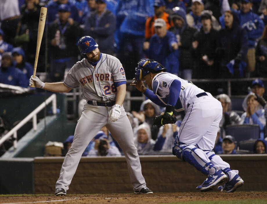 Kansas City Royals catcher Salvador Perez goes back to the dug out after New York Mets' Daniel Murphy struck out looking during the sixth inning of Game 2 of the Major League Baseball World Series Wednesday, Oct. 28, 2015, in Kansas City, Mo. (AP Photo/Matt Slocum)