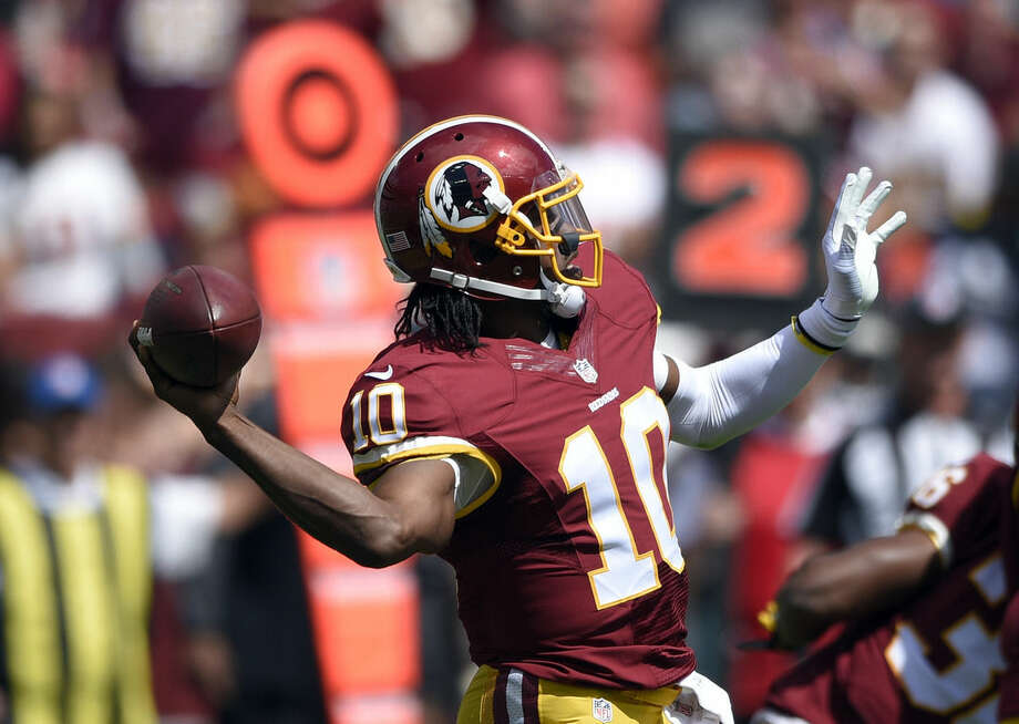 Washington Redskins quarterback Robert Griffin III (10) passes the ball during the first half of an NFL football game against the Jacksonville Jaguars, Sunday, Sept. 14, 2014, in Landover, Md. (AP Photo/Nick Wass)