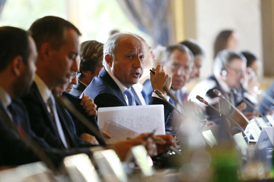 "French Foreign Minister Laurent Fabius, center, attends an international conference intended to come up with an international strategy against the Islamic State group, in Paris, Monday, Sept. 15, 2014. Reconnaissance planes at the ready, France's president Francois Hollande said there was ""no time to lose"" in the global push to combat extremists from the Islamic State group as he opened an international conference to attack the problem _ minus the two countries who share most of Iraq's borders. (AP Photo/Yoan Valat/ Pool)"