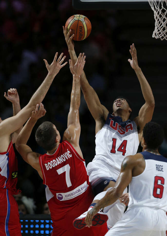 United States' Anthony Davis vies for the ball against Serbia's Bogdan Bogdanovic during the final World Basketball match between the United States and Serbia at the Palacio de los Deportes stadium in Madrid, Spain, Sunday, Sept. 14, 2014. (AP Photo/Daniel Ochoa de Olza)