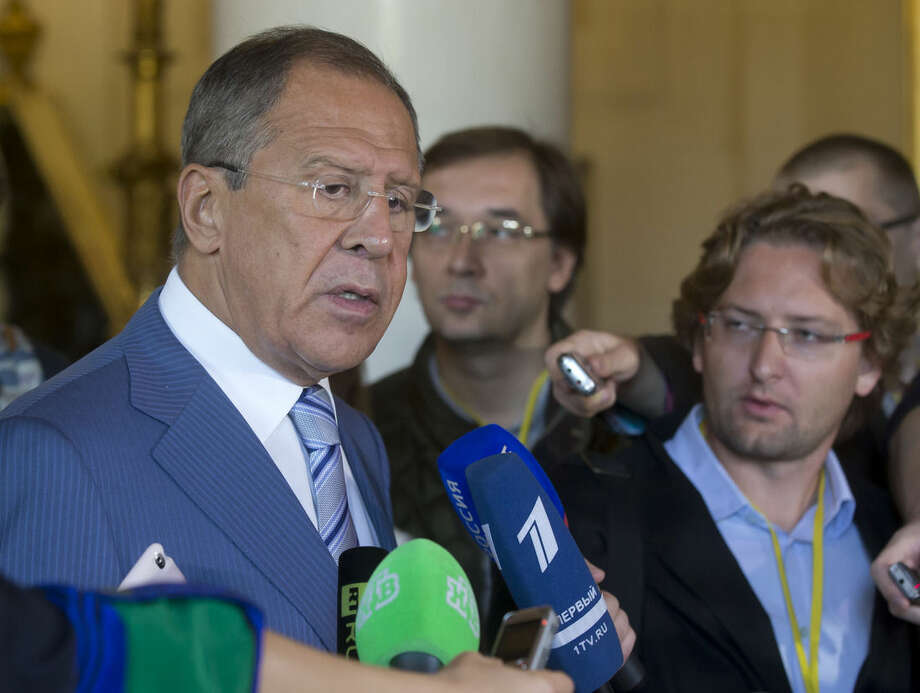 Russian Foreign Minister Sergei Lavrov, speaks to the media after a meeting about the Islamic State group at the French Foreign ministry in Paris, Monday Sept. 15, 2014. Diplomats from around the world are in Paris pressing for a coherent global strategy to combat extremists from the Islamic State group. (AP Photo/Michel Euler)