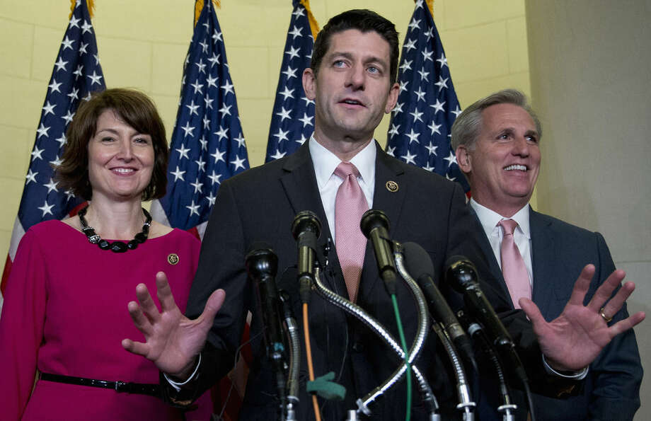 Rep. Paul Ryan, R-Wis., flanked by Rep. Cathy McMorris Rodgers, R-Wash., left, and House Majority Leader Kevin McCarthy of Calif., speaks during a news conference on Capitol Hill in Washington, Wednesday, Oct. 28, 2015, after a Special GOP Leadership Election. Republicans in the House of Representatives have nominated Ryan to become the chamber's next speaker, hoping he can lead them out of weeks of disarray and point them toward accomplishments they can highlight in next year's elections. (AP Photo/Carolyn Kaster)