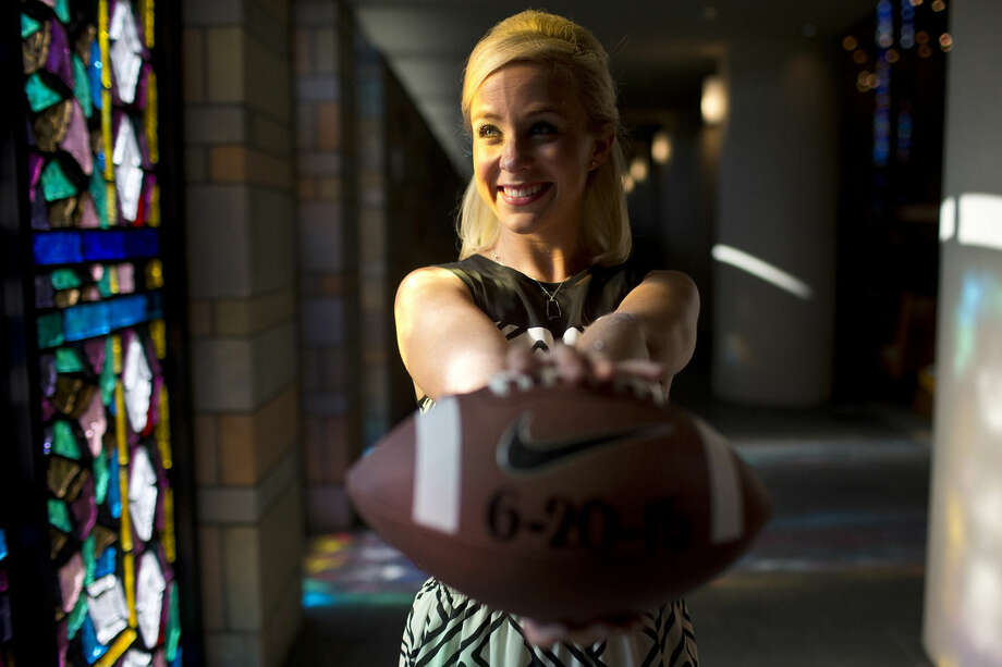 Hold for College Football Weddings story. Emily Younker poses for a portrait on Friday, Sept. 12, 2014, in Montgomery, Ala. She isn't getting married until next year but she's already made sure the date doesn't conflict with college football. (AP Photo/Brynn Anderson)