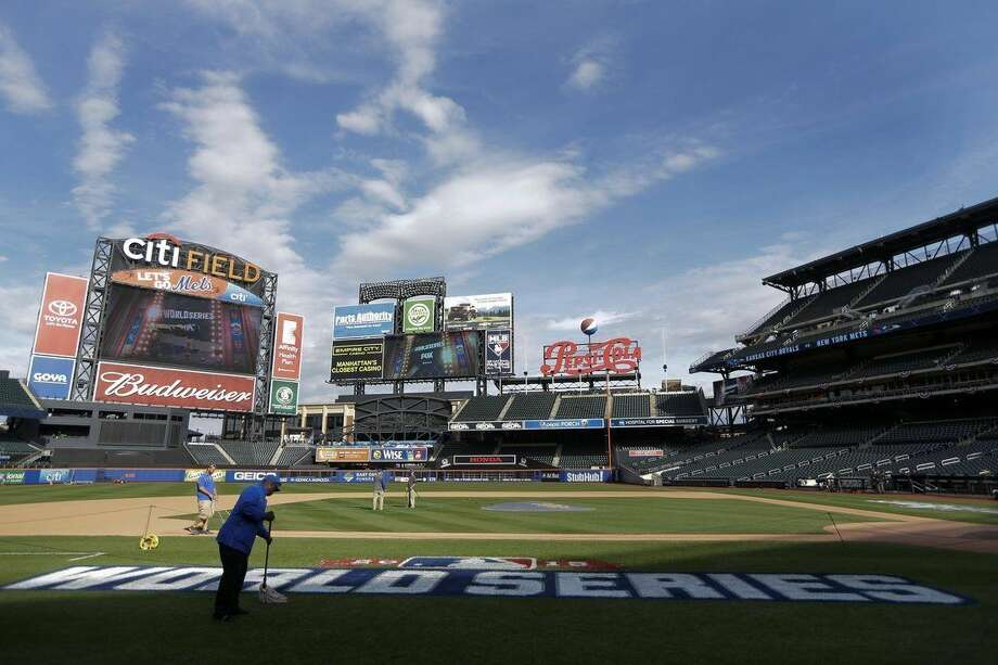 Grounds crews work on the field at Citi Field preparing for Game 3 of the Major League Baseball World Series between the New York Mets and the Kansas City Royals Thursday, Oct. 29, 2015, in New York. (AP Photo/Frank Franklin II)