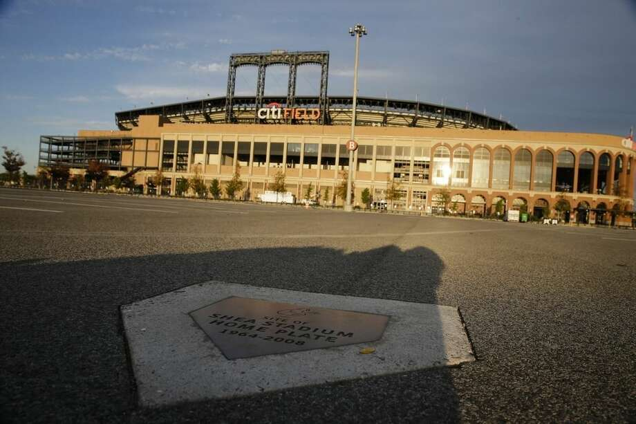 A plaque marking the original position of home plate at the old Shea Stadium is viewed near Citi Field before Friday's Game 3 of the Major League Baseball World Series between the New York Mets and the Kansas City Royals, Thursday, Oct. 29, 2015, in New York. (AP Photo/Peter Morgan)