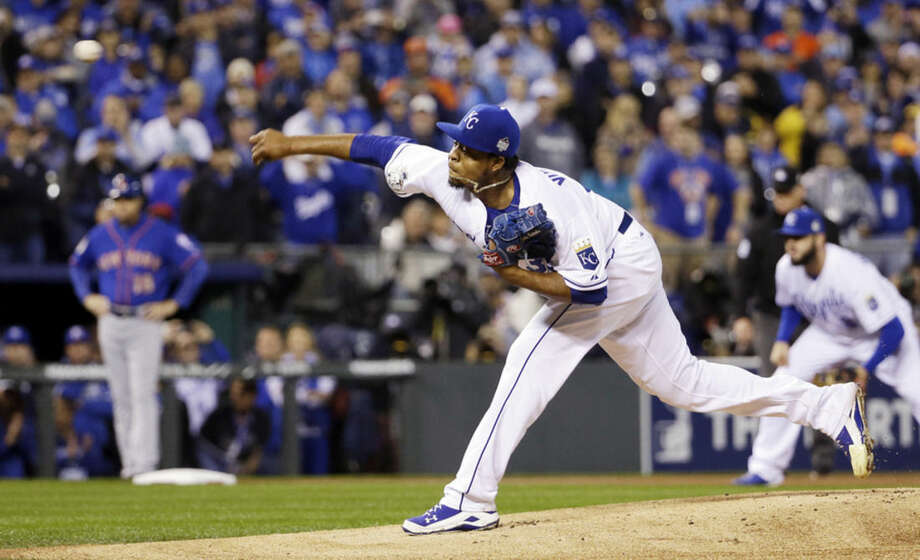 Kansas City Royals pitcher Edinson Volquez throws during the first inning of Game 1 of the Major League Baseball World Series against the New York Mets Tuesday, Oct. 27, 2015, in Kansas City, Mo. (AP Photo/David J. Phillip)