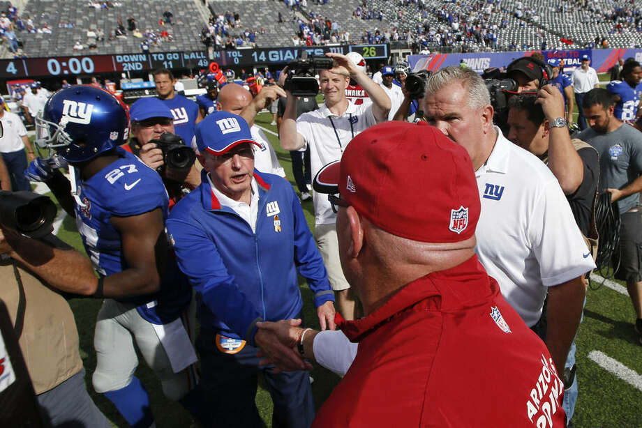 New York Giants head coach Tom Coughlin shakes hands with Arizona Cardinals head coach Bruce Arians after an NFL football game Sunday, Sept. 14, 2014, in East Rutherford, N.J. The Cardinals won the game 25-14. (AP Photo/Kathy Willens)