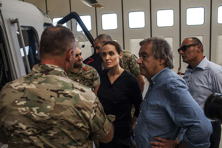 In this image made available from the UNHCR on Monday Sept. 15, 2014 American actress, Angelina Jolie, centre, who serves as Special Envoy for the United Nations High Commission for Refugees, listens to officers in the Maltese military discuss rescue at sea operations for refugees at a military base in Valetta, Malta on Sunday, Sept. 14, 2014. Since the start of 2014, more than 2,500 asylum seekers have perished trying to cross the Mediterranean. (AP Photo/Pete Muller/UNHCR)