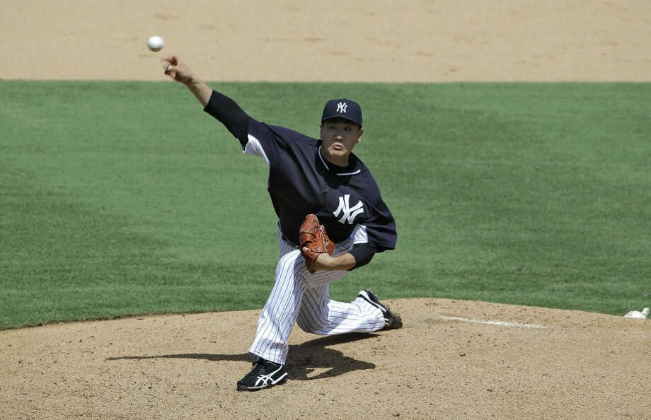 New York Yankees pitcher Masahiro Tanaka, of Japan, delivers during a simulated game Monday, Sept. 15, 2014, in Tampa, Fla. Tanaka pitched five scoreless innings against minor leaguers in an instructional league simulated game Monday, perhaps the final step before the injured Japanese pitcher rejoins the New York Yankees. (AP Photo/Chris O'Meara)