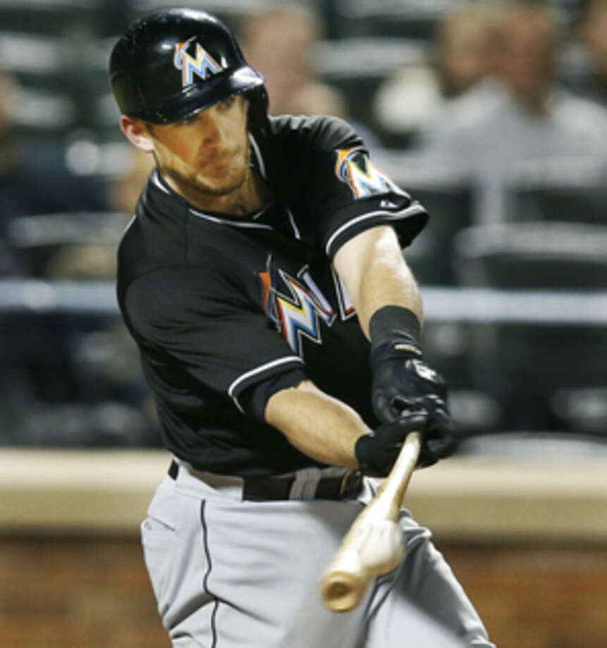Miami Marlins Jeff Mathis hits an eighth-inning RBI single in a baseball game against the New York Mets in New York, Monday, Sept. 15, 2014. (AP Photo/Kathy Willens)