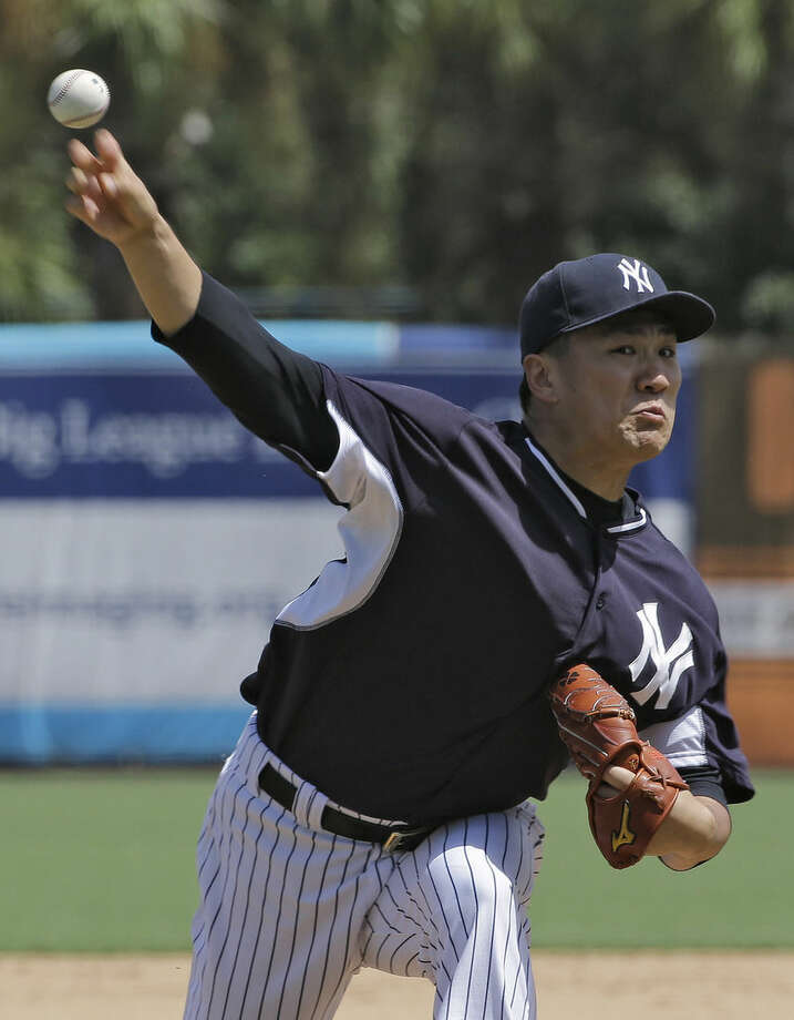 New York Yankees pitcher Masahiro Tanaka, of Japan, delivers during a simulated game Monday, Sept. 15, 2014, in Tampa, Fla. Tanaka is rehabbing his right elbow. (AP Photo/Chris O'Meara)