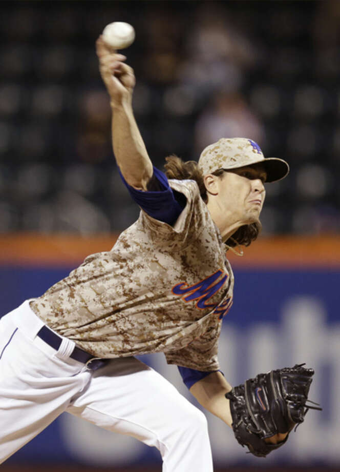 New York Mets starting pitcher Jacob deGrom delivers in the first inning of a baseball game against the Miami Marlins in New York, Monday, Sept. 15, 2014. (AP Photo/Kathy Willens)