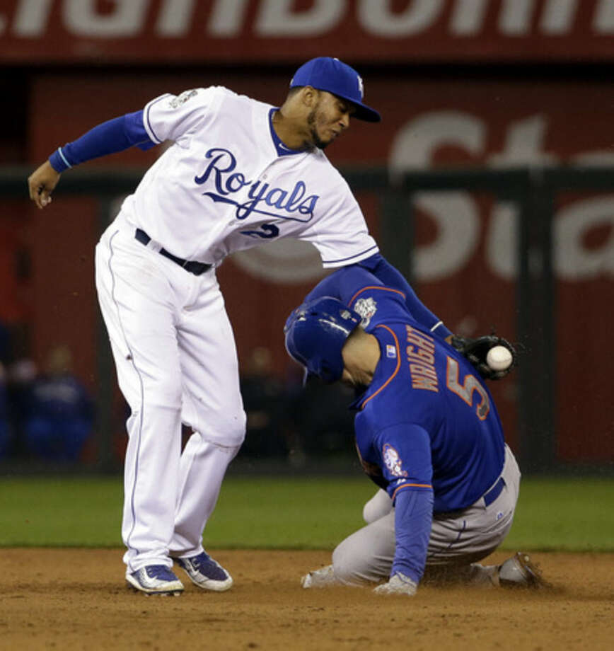 Kansas City Royals' Alcides Escobar tags out New York Mets' David Wright as he is caught stealing second during the ninth inning of Game 1 of the Major League Baseball World Series Tuesday, Oct. 27, 2015, in Kansas City, Mo. (AP Photo/David J. Phillip)
