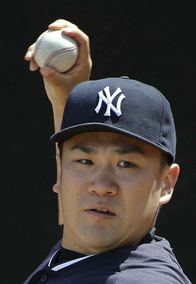 New York Yankees pitcher Masahiro Tanaka, of Japan, warms up in the bullpen before throwing a simulated game Monday, Sept. 15, 2014, in Tampa, Fla. Tanaka pitched five scoreless innings against minor leaguers in an instructional league simulated game Monday, perhaps the final step before the injured Japanese pitcher rejoins the New York Yankees. (AP Photo/Chris O'Meara)
