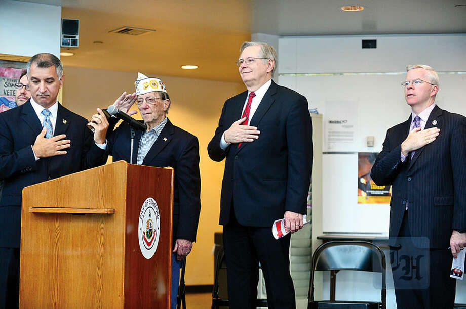 Hour photo / Erik Trautmann Local officials attend an award ceremony for the Connecticut Veterans Wartime Service Medal hosted by State Senator Carlo Leone, left, and Sean Connolly from the CT Department of Veterans' Affairs, right, at the Stamford Government Center Wednesday morning. The Connecticut Veterans Wartime Service Medal was created by the legislature in 2005 to honor all Connecticut veterans with qualifying wartime military service.