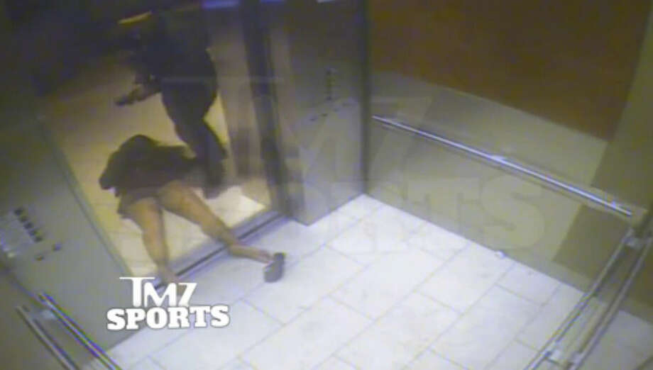 In this still image taken from a hotel security video released by TMZ Sports, Baltimore Ravens running back Ray Rice drags his fiancee, Janay Palmer, out of an elevator moments after knocking her off her feet into the elevator's railing at the Revel casino in Atlantic City, N.J., in February 2014. The Ravens terminated their contract with Rice Monday, Sept. 8, 2014, hours after the video surfaced on TMZ's website, and he was suspended indefinitely by the NFL. (AP Photo)