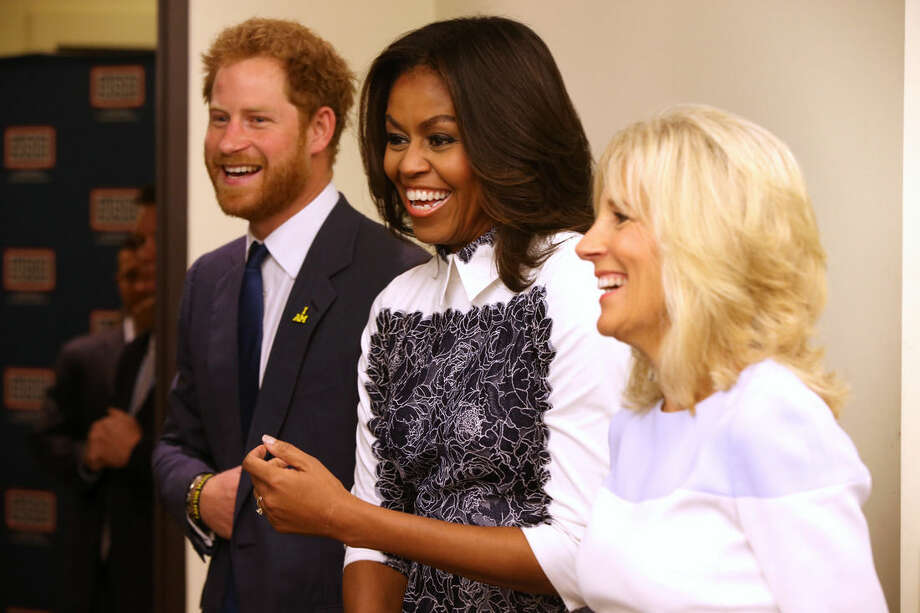Britain's Prince Harry, first lady Michelle Obama and Jill Biden tour the USO Warrior and Family Center at the Fort Belvoir military base, Wednesday, Oct. 28, 2015, at Fort Belvoir, Va. The event is being held in support of the Invictus Games Orlando 2016. (AP Photo/Andrew Harnik)