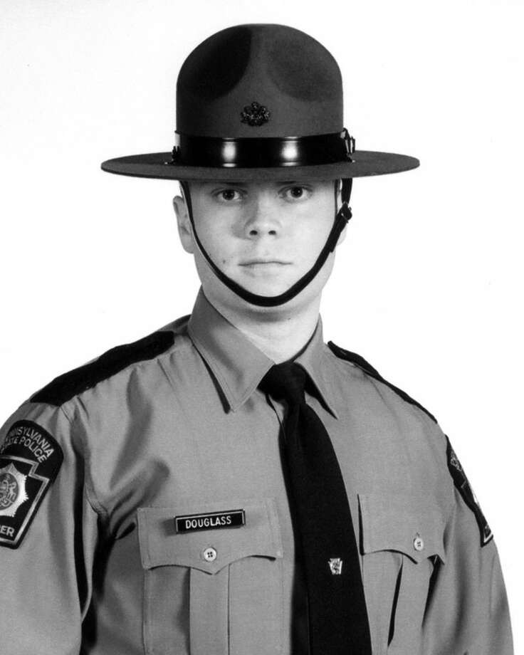 This photo provided by Pennsylvania State Police shows Trooper Alex Douglass. Investigators on Sunday, Sept. 14, 2014 returned to scour the woods across from a state police barracks where two troopers were ambushed, injuring Douglass and killing Cpl. Bryon Dickson. (AP Photo/Pennsylvania State Police)