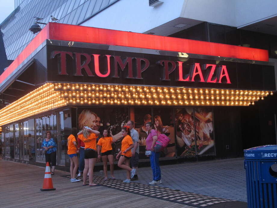 FILE - In this July 24, 2014 file photo, several lights are burned out in the illuminated facade of Trump Plaza Hotel Casino in Atlantic City N.J. Trump Plaza is closing on Tuesday Sept. 16, 2014, the fourth Atlantic City casino to go out of business so far this year.(AP Photo/Wayne Parry, FILE)